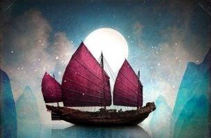 Een schip bij volle maan