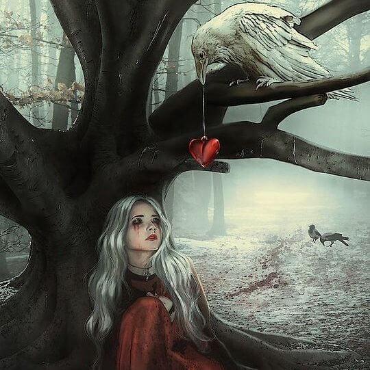 Vrouw zit verdrietig in het bos omdat ze steeds de verkeerde partner kiest