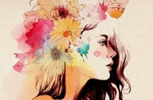 Vrouw Met Kleurrijke Bloemen In Haar Haar Al Denkend Hoe Ze Kan Omgaan Met Lastige Situaties