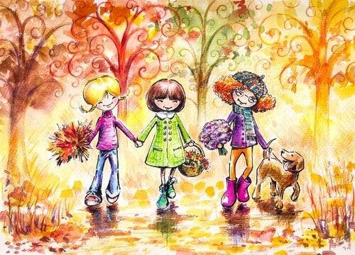 Drie meiden die samen met een hond door het park lopen om bloemen te plukken want geluk verspreidt zich door te lachen