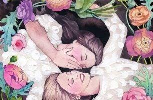 Twee meiden die tussen de bloemen liggen en samen lachen want geluk verspreidt zich door te lachen