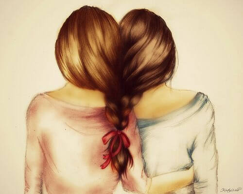 Twee meisjes wiens haar in elkaar gevlochten is want liefde is samen willen zijn