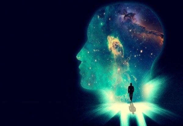 De omtrek van een hoofd van een man waar allemaal sterren in te zien zijn en een man doorheen loopt