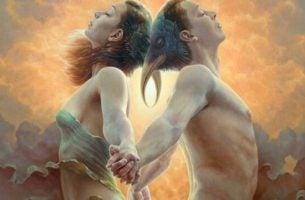 Een man en een vrouw die in hun blote bast met de ruggen tegenover elkaar staan en elkaars handen vasthouden als voorbeeld van oprechte liefde