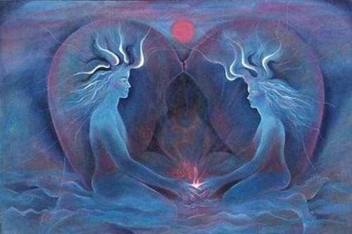 Man en een vrouw de elkaar voor een hart vasthouden als symbool voor volwassen liefde