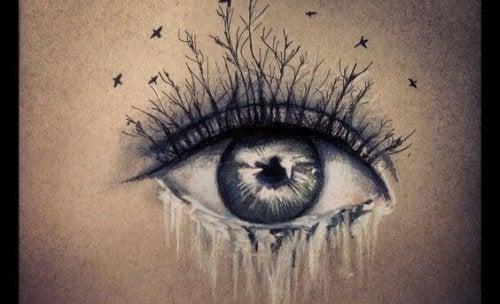 Vrouw wiens wimpers in takken veranderen en haar onderwimpers in een waterval van tranen