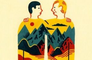 Twee mannen wiens truien samen een afbeelding vormen van een paar bergen