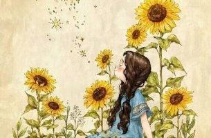 Meisje dat tussen de zonnebloemen staat
