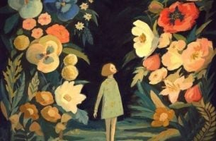 Meisje dat tussen allemaal reuzebloemen staat en het voorbeeld is van hoe optimistische mensen zijn