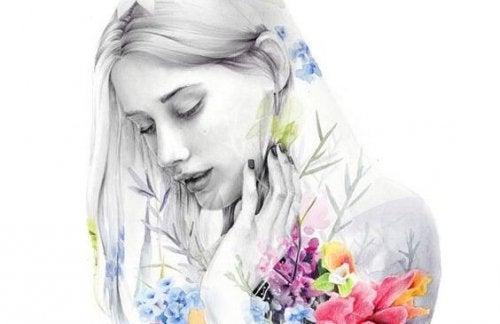 Meisje in het zwart-wit met gekleurde bloemen om zich heen