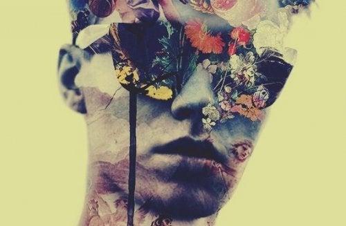 Man met een zonnebril op wiens gezicht helemaal bedekt is met bloemen want hij heeft geen intimiderende persoonlijkheid
