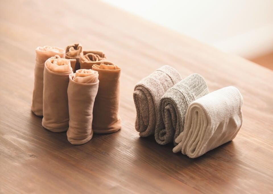 Panty's en sokken die heel netjes zijn opgevouwen
