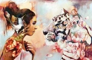 Meisje dat oog in oog staat met een tijger