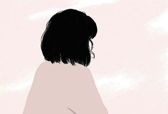 Meisje dat met voor zich uit kijkt en nadenkt