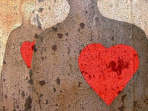 De omtrek van twee figuren wiens harten knalrood en groot zijn
