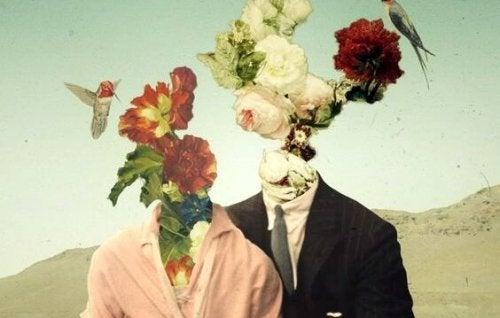 Een man en een vrouw met bloemen in plaats van hoofden