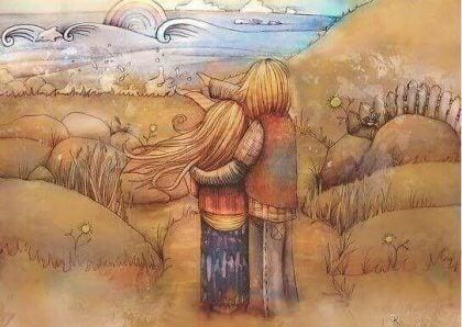 Twee mensen die elkaar omhelzen en vanuit de duinen naar de zee kijken en elkaars onvolmaaktheden aanvaarden