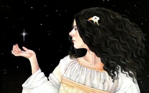 Vrouw die haar hand onder een ster houdt omdat ze karakter heeft