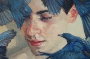 Gezicht van een jongen die lijdt aan afhankelijke persoonlijkheidsstoornis met meerdere blauw-zwarte vogels eromheen