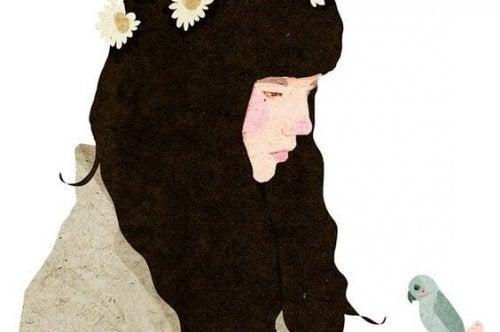 Eenzaam meisje met zwart haar dat staart naar een vogeltje, maar het maakt niet uit, want eenzaamheid beschermt ons