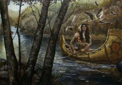 Indiaan die in een kano vaart vanwege de sioux-legende