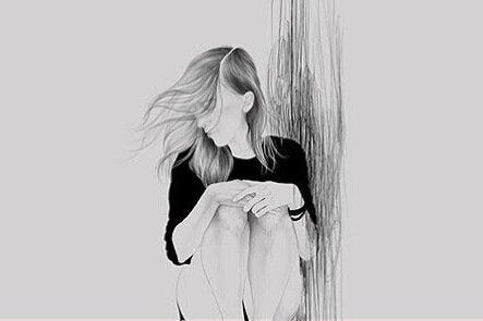 Meisje dat op de grond zit en wiens haar naar zij waait en ze denkt na over of ze wel een goede mentale gezondheid heeft