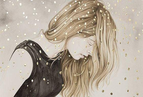 Blond meisje dat in de sneeuw staat