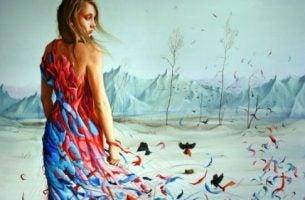 Vrouw in een gekleurde jurk die recht op een uitgestorven landschap loopt want ze zal taai zijn