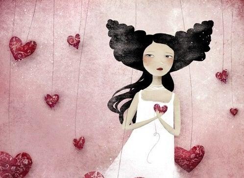 Meisje dat stevig haar hart vasthoudt want zij is een van die mensen die gewond zijn geraakt