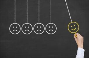 Vier droevige smileys en een lachende smiley die wist hoe hij het meeste uit zijn sessies met een psycholoog kon halen