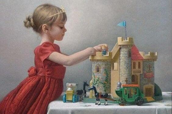 Braaf meisje dat keurig aan het spelen is met haar kasteel