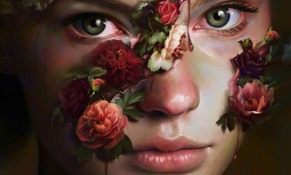 Braaf meisje met rozen op haar gezicht