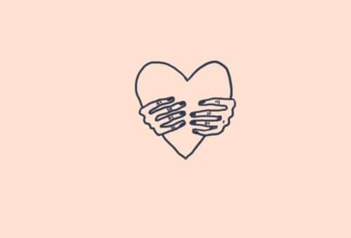 Tekening van twee handen die een hart vasthouden