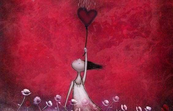 Meisje dat een hartjesballon vasthoudt als paraplu