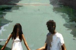 Stelletje dat elkaars handen vasthoudt