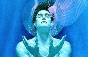 Man die onderwater gekust wordt door een vrouw en denkt ik ben verantwoordelijk voor mijn geluk