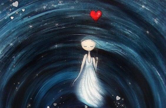 Meisje dat met een hartjesballon in een wervelwind staat en nadenkt over een beter leven