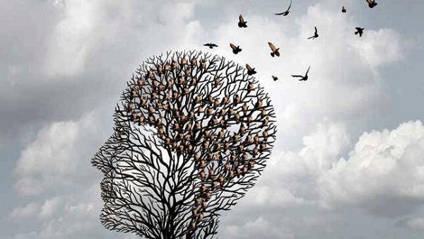 Hoofd dat het geraamte van een boom is waar vogels uitvliegen