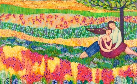 Een gelukkig stel in een bloemenveld dat geniet van de overvloed in hun leven