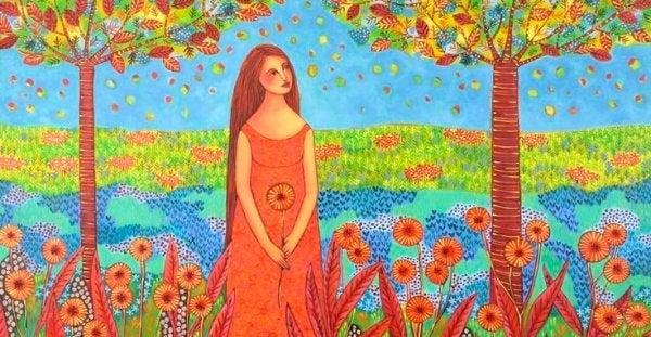 Vrouw in een bloemenveld die geniet van de overvloed in haar leven