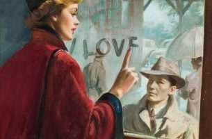 Vrouw die liefde schrijft op een raam