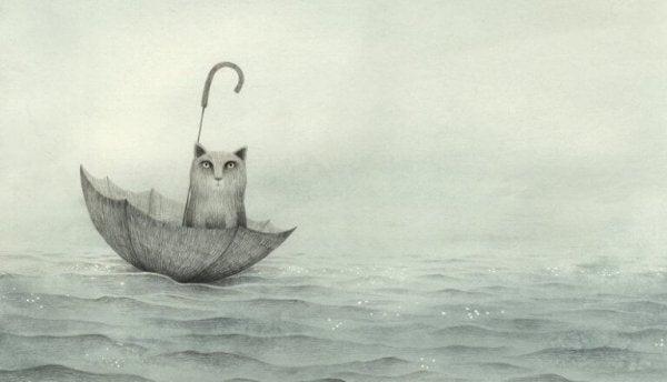 Poes die in een paraplu op zee drijft