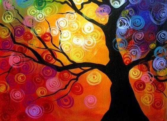 Zwarte boom tegen een kleurrijke achtergrond