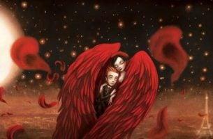 Chemie van de liefde zichtbaar onder twee mensen die samen schuilen onder twee rode vleugels