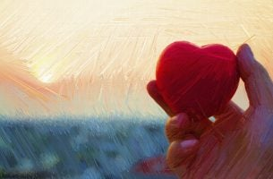 Hand houdt een hart vast als voorbeeld van ongezonde emotionele afhankelijkheid