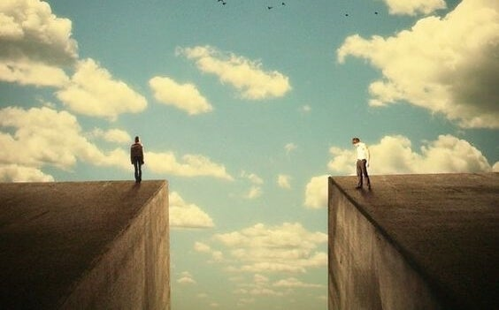 Een grote kloof tussen twee mensen die op wolkenkrabbers staan