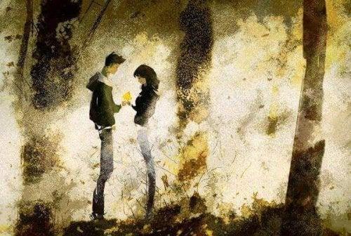 Twee mensen in het bos die elkaar liefde tonen