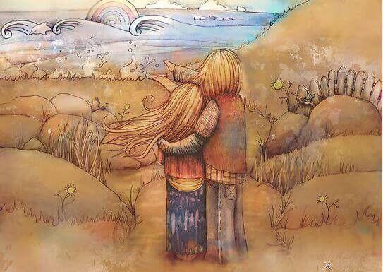 Twee mensen kijken samen naar de golven