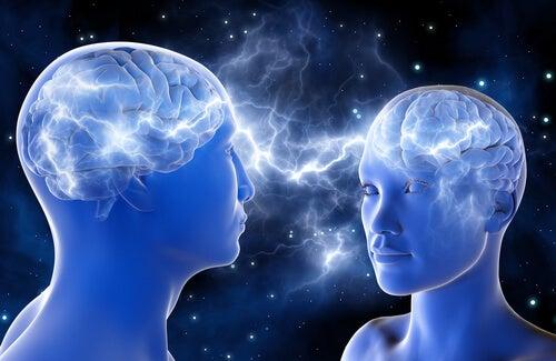 Twee mensen die via hun hersenen met elkaar in verbinding staan