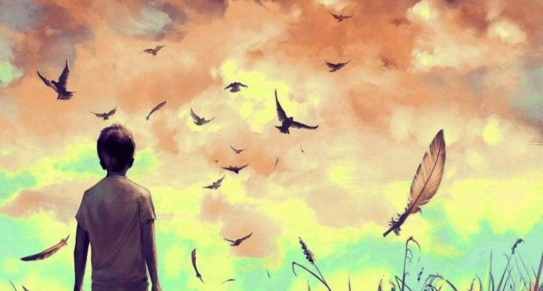 Jongetje dat na het verlies van een dierbare hoopvol naar de lucht kijkt